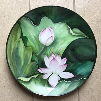 Flowers painted on porcelain plate.