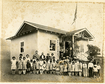 A large group of children are photographed outside of the Palos Verdes Langauge School and Portuguese Bend Community Center.