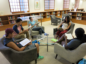 Students using the Gohstand Reading Room at the Oviatt Library