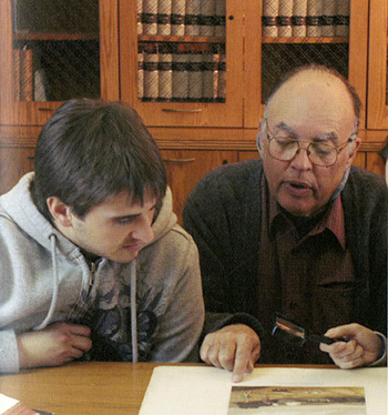 Tony Gardner in Special Collections with a student.