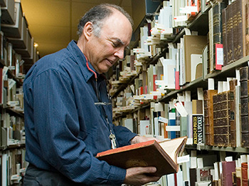 Tony Gardner browsing books in Special Collections