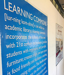 Signs on a Construction Wall Promoting the Upcoming Learning Commons