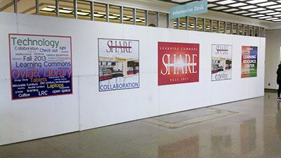 Future Site of the new Freudian Sip with Posters Advertising the Learning Commons