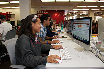 Students using the computer stations in the Oviatt Library Learning Commons