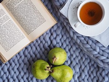 a book, pears and a cup of tea