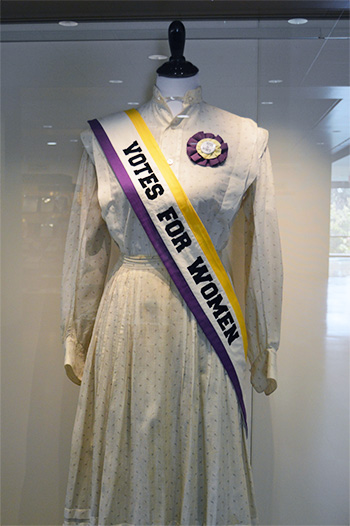 woman's dress with sash reading: votes for women