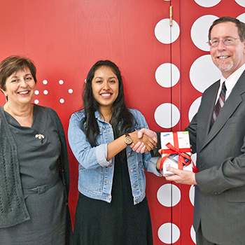 Dean Mark Stover, Associate Dean Marianne Afifi and Raffle Winner Karla Itzep