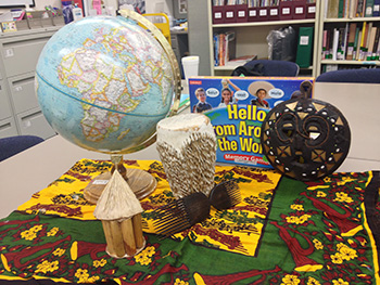 A globe, toys, and other learning materials from the Teacher Curriculum Center