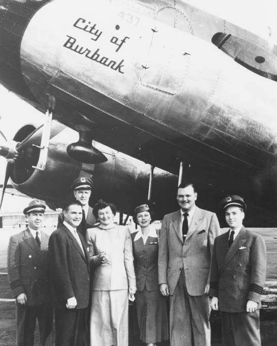 Colonel Charles C. Sherman and his wife Edna K. Sherman being congratulated on a first successful year leading California Central Airlines, 1950